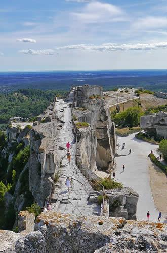 Elegant Set Upon A Rocky Outcrop, The Castle Of Les Baux Dominates The Medieval  Village Of Les Baux De Provence And Offers Incredible Panoramic Views Over  The ...